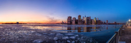 view of Manhattan skyline over a frozen harbor